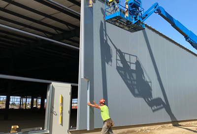 Hanging Falk Hidden Fastener Wall Panels on a perfect Michigan day.